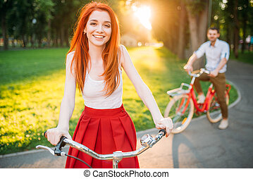 Couple on retro bicycles on sunset, romantic date