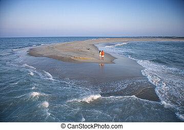 Couple on sandbar. - Birds eye view of couple on sandbar at ...