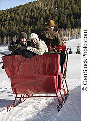 Couple on sleigh ride.