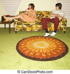 Couple on sofa.