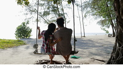 Couple On Swing Communication Back Rear View Taking Selfie...