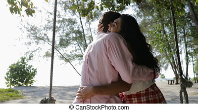 Couple On Swing Embracing, Back Rear View Happy Man And...