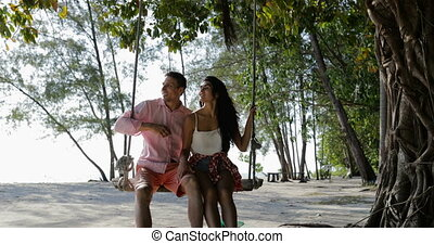 Couple On Swing, Guy Point Finger Aside, Man And Woman...