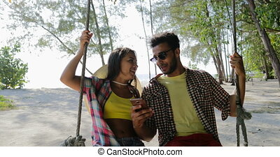 Couple On Swing Taking Selfie Photo On Cell Smart Phone...
