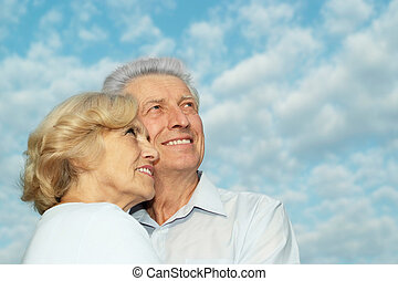 Couple on the background of sky