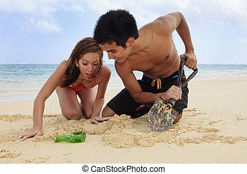 couple on the beach in hawaii