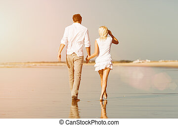 Couple on the beach in summer vacation