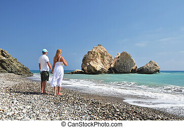 Couple on the beach near Aphrodite birthplace, Cyprus
