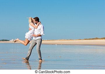 Couple on the beach running into glorious future - Couple on...