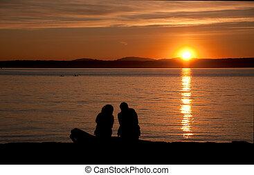 Couple on the beach sunset