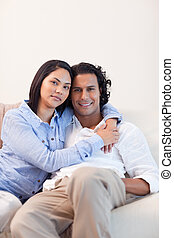Couple on the couch embracing