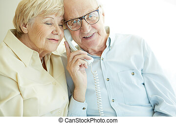 Couple on the phone - Portrait of elderly man looking at...