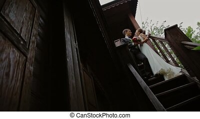 Couple on the stairs of an old wooden house