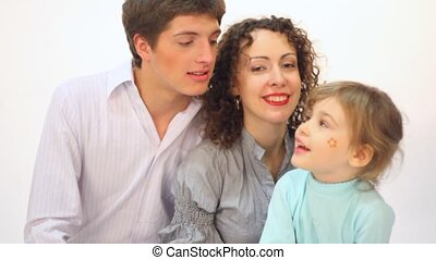 Couple on the white background, and kid with painted face