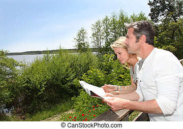 Couple on vacation looking at touristic map