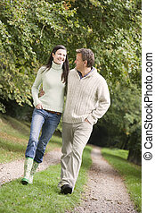 Couple on walk along woodland path