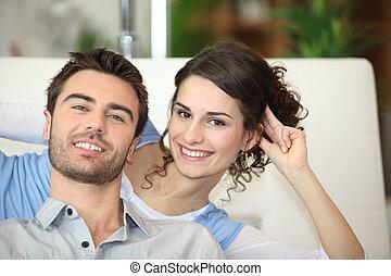 Couple on white sofa