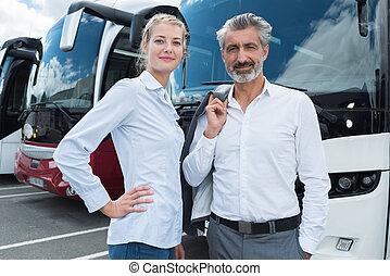 couple outside bus