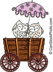 Couple owls with umbrella on wooden trolley