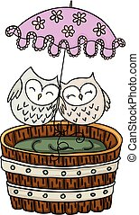 Couple owls with umbrella on wooden tub for a bath