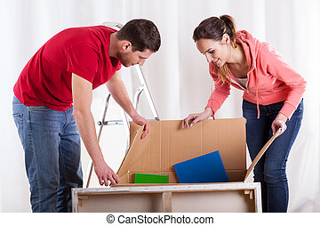 Couple packing things