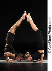 Couple pacticing yoga