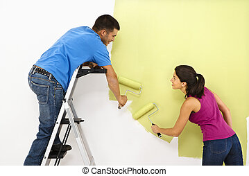 Couple painting home. - Attractive young adult couple...