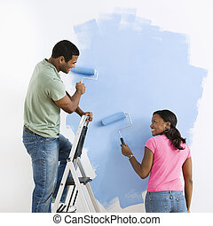 Couple painting together.