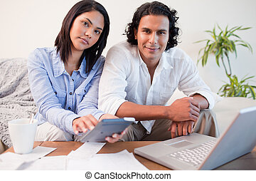 Couple paying their bills online