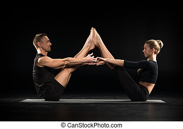 Couple performing acroyoga