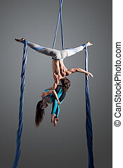 couple performing aerial silk dance - Sporty couple doing...