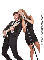 Couple performs duet to everybody - Couple performs duet...