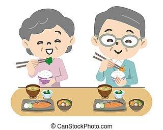 couple, personnes agées, manger, sourire