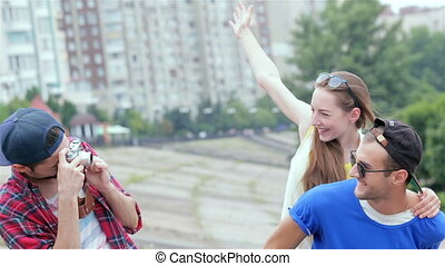 Couple photographed. The guy takes pictures of his friends