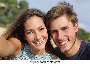 Couple photographing a selfie with the smart phone