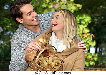 Couple picking mushrooms