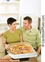 couple, pizza mangeant