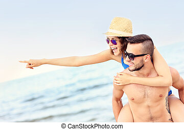couple, plage, jeune, pointage, quelque chose