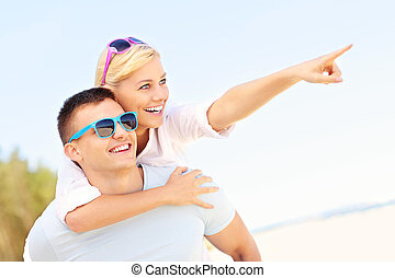 couple, plage, pointage