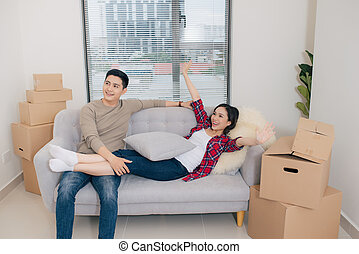 Couple planning decoration new home in the living room