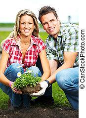 couple planting flowers