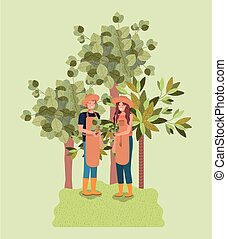 couple planting tree in the park