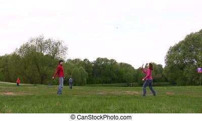 couple play badminton