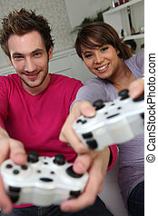 Couple playing a games console