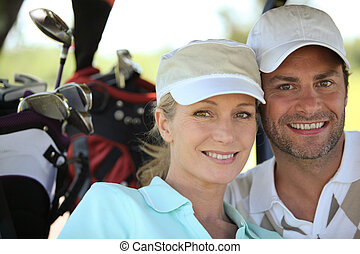 Couple playing a round of golf
