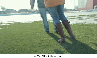 Couple playing and running on the football football field