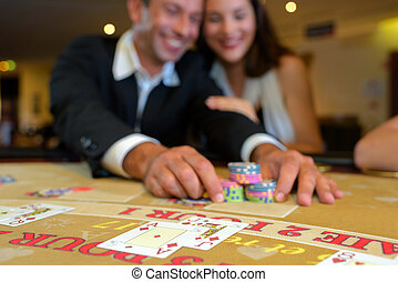 Couple playing at casino table