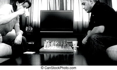 Couple playing chess,time lapse during the game and slow motion at the end