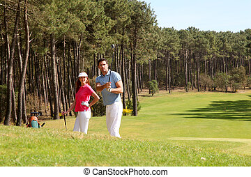 Couple playing golf on a sunny day