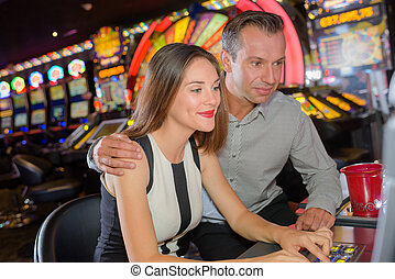 couple playing in casino